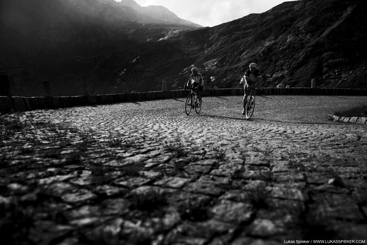 Cyclists climb on the paved Tremola road over the Gotthard mountain pass.