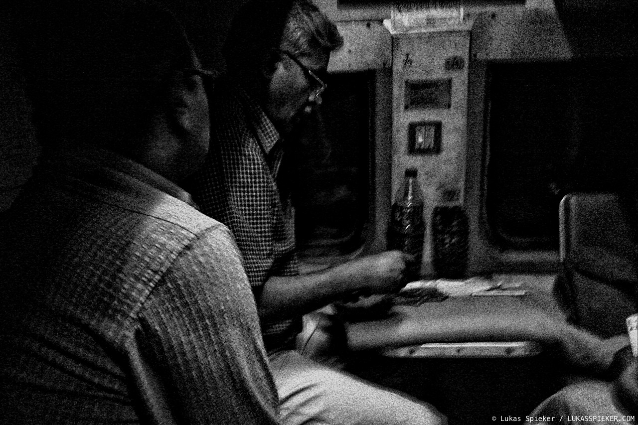 Men play cards in the night train from Jodhpur to Delhi, India.